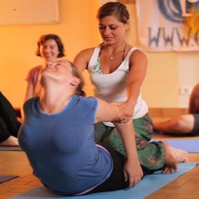 yoga adjustment vs assists